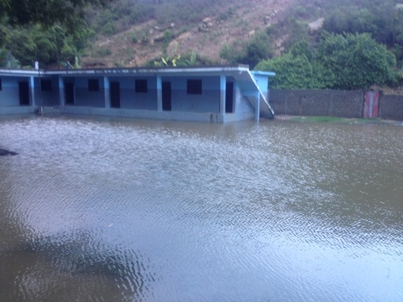 Flooded schoolyard adjacent to the clinic at Bod me Limbe.