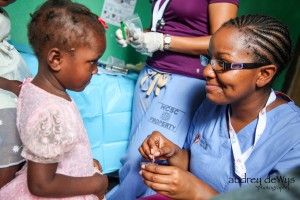 Nurse Alicia Benton convinces a little girl to take her medication with the help of some peanut butter.