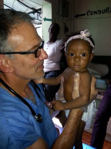 Pediatrician Dr. Elliot Barsh seeing a young patient in Haiti