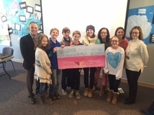 The Student Council presents a check to Drs. Ratner and Barsh for Hands Up for Haiti.
