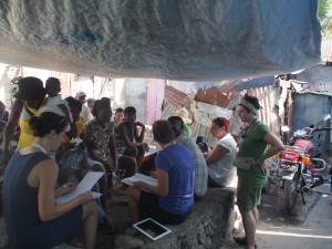 Dr. Mary Ann listening in as HUFH volunteer Jenn leads a focus group in Shada