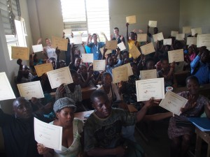 Students Proudly Showing Off Certificates at the End of a Day of Study