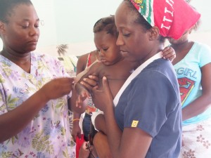 Nurse Youselene who helps run our Medika Mamba program orients volunteer nurse Gayrleen.